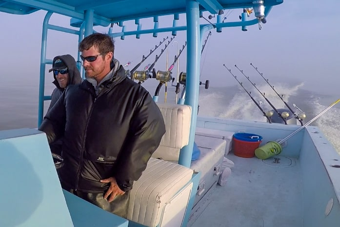 captain scott leger driving the 41-foot custom charter boat in the gulf of mexico